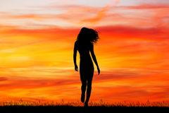 Beautiful girl walking at sunset Royalty Free Stock Image