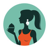 An illustration of beautiful woman holding cupcake Royalty Free Stock Photography