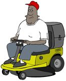 Ethnic man mowing grass on a riding lawnmower Stock Photography