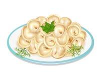 boiled dumplings on a plate Stock Image