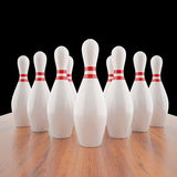 Illustration of bowling pins on a wooden floor. 3d high resolution image Stock Photography