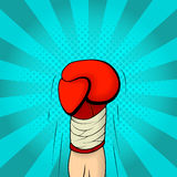 Illustration of boxing glove raised up on the retro background in pop art style Royalty Free Stock Photo