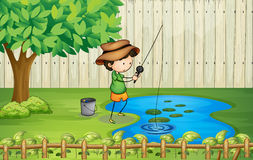 A boy fishing at the pond Royalty Free Stock Photos