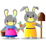 Illustration of bunnies with carrots and shovel, bucket Royalty Free Stock Photos