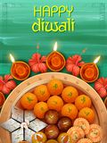 Burning diya with assorted sweet and snack on Happy Diwali Holiday background for light festival of India Stock Images