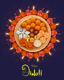 Burning diya with assorted sweet and snack on Happy Diwali Holiday background for light festival of India Royalty Free Stock Photos