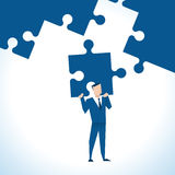 Illustration Of Businessman With Last Piece Of Jigsaw Puzzle Stock Images