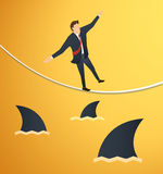 Illustration of a businessman walking on rope with sharks underneath business risk chance. EPS10 vector illustration