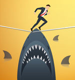 Illustration of a businessman walking on rope with sharks underneath business risk chance. EPS 10 royalty free illustration