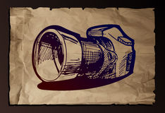 Illustration of camera on old paper background. Stock Photos