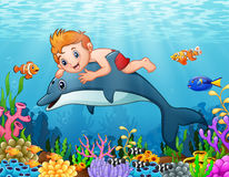 Cartoon boy with dolphin swimming. Illustration of Cartoon boy with dolphin swimming Royalty Free Stock Photo