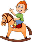 A cartoon boy riding a horse toy. Illustration of a cartoon boy riding a horse toy Stock Photo