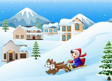 Cartoon boy riding sled on the downhill pulled by two dogs Royalty Free Stock Image