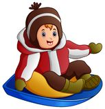 Cartoon boy in winter clothes playing a sledge. Illustration of Cartoon boy in winter clothes playing a sledge Stock Photography