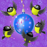 Illustration of cartoon titmouses and a Christmas ball on the theme of winter sales Royalty Free Stock Photo