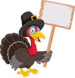 Cartoon turkey holding blank sign. Illustration of Cartoon turkey holding blank sign Royalty Free Stock Photography