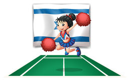 A cheerleader dancing in front of the Israel flag Royalty Free Stock Photo
