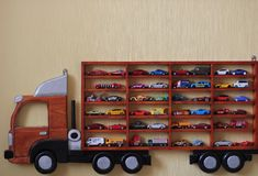 Truck with cars. Illustration of a child`s room Truck with cars Royalty Free Stock Photo