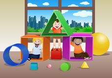 Children playing shape boxes Royalty Free Stock Photo