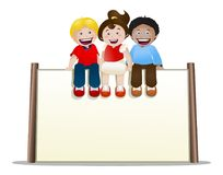 Childrens sit on top of blank banner sign on isolated Royalty Free Stock Photo