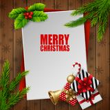 Christmas card with fir tree branches and gift boxes on wood background. Illustration of Christmas card with fir tree branches and gift boxes on wood background Royalty Free Stock Images