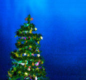Illustration of Christmas tree on blue Stock Image