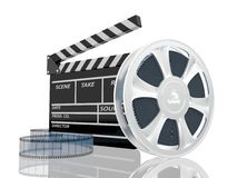 Illustration of cinema clap and film reel. Over white background Stock Images