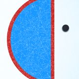 Hockey surface with puck Stock Image