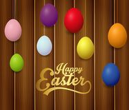 Colorful Easter eggs with lettering Happy Easter on brown wooden background. Illustration of Colorful Easter eggs with lettering Happy Easter on brown wooden Stock Photography