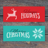 Illustration of colorful paper cards with Happy Holidays. And Merry Christmas lettering. Christmas calligraphy on wood background. Vector banners. Xmas Royalty Free Stock Image