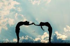 Couple makes yoga poses at sunset. Illustration of couple makes yoga poses at sunset Stock Image