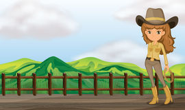 A cowgirl in the bridge Royalty Free Stock Photos