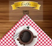 Cup of coffee with yellow ribbon and coffee beans on brown wooden background Royalty Free Stock Photos