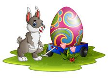 Cute easter bunny with large eggs painted on a cart vector illustration