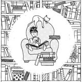 Young girl sitting in an armchair, reading a book Stock Image