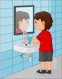 Cute little boy washing his hands in the bathroom vector illustration