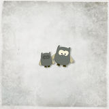 Illustration of a cute owls. On a gray textured background Royalty Free Stock Photos