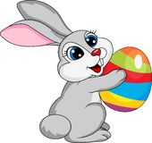 Cute rabbit holding ester egg Royalty Free Stock Images