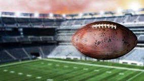 illustration 3d av att flyga amerikansk fotboll som lämnar en slinga av rök Roterande smutsigt amerikanskt footbal Arkivbilder