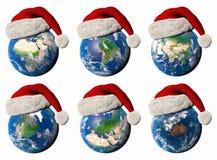 illustration 3D av jorden med en jultomtenhatt Royaltyfri Fotografi