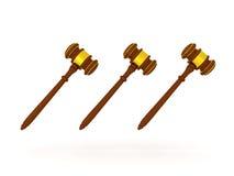 illustration 3D de trois marteaux d'or Image libre de droits