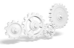 Interconnecting cogwheels Stock Photo