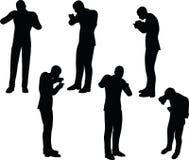 Illustration de vecteur d'ENV 10 en silhouette d'homme d'affaires se tenant mangeant Photographie stock