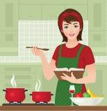 Femme au foyer dans la cuisine Photo stock