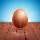 Illustration de vecteur des vacances heureuses de Pâques avec l'oeuf en bois sur le fond de nature de vintage Célébration interna Image libre de droits