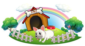 A dog in a doghouse with fence Royalty Free Stock Photos