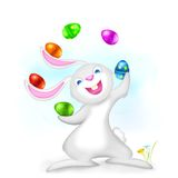 Juggling Easter Bunny. Illustration of Easter bunny juggling with colorful egg Stock Photo