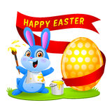 Easter bunny rabbit paints egg Royalty Free Stock Images