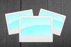 Illustration of empty blue photo frames on black wooden background Royalty Free Stock Image
