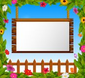 Empty paper blank on wooden signboard in the garden Stock Photography